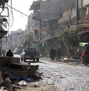 Esad yine katliam yaptı,Beşşar Esad'a bağlı ordu birliklerinin düzenlediği operasyonlarda:34 kişi öldü