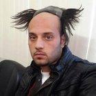 Adana'da peruklu dolandırıcı yakalandı
