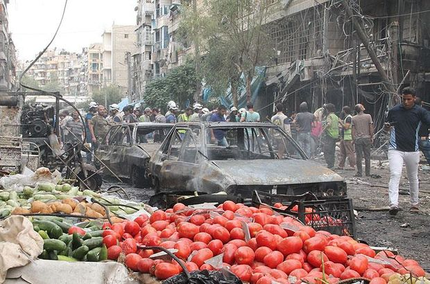 Suriye'de çarşıya füze saldırısı: 25 ölü