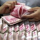 Çin'de tedavülden kalkmış paralar imha edildi