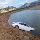 Kızılırmak Nehri'ne uçan otomobilde burunları bile kanamadı