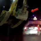 İş makinesini vinçle akan trafiğin üzerinden geçirdiler!