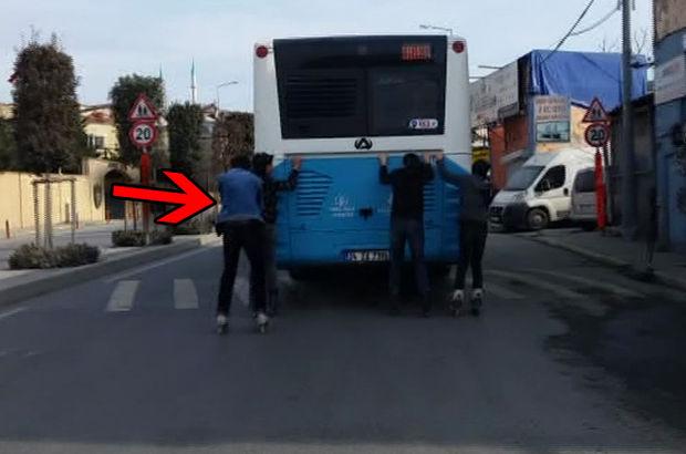 Alibeyköy'de halk otobüsünün arkasına takılan dört patenci genç