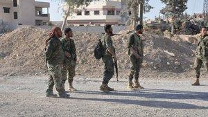Humus'ta Esed rejiminin güvenlik merkezlerine intihar saldırısı: 32 ölü