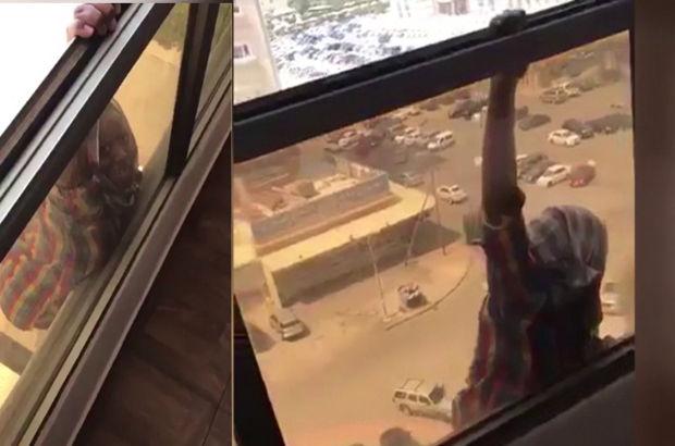 Düşmek üzere olan Etiyopyalı çalışanını kurtarmak yerine videoya çekti! (video)