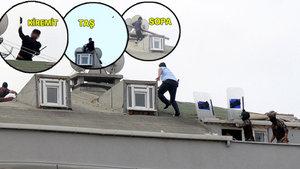 Çatıya çıkan kişi araçların üzerine kiremit attı