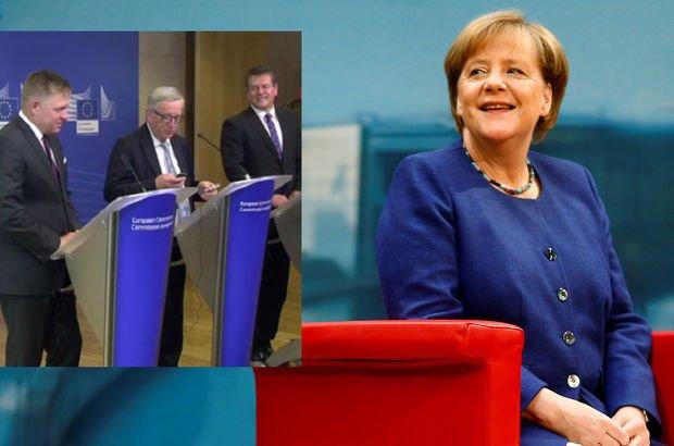 Telefonu Merkel'in yüzüne kapadı