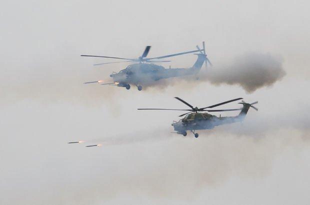 Rus helikopteri tatbikatta park halindeki araçları vurdu! Akılalmaz kaza...