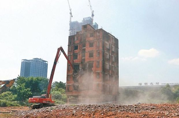 7 yıldır yıkımına direndiği binasından 72 milyon TL'ye vazgeçti