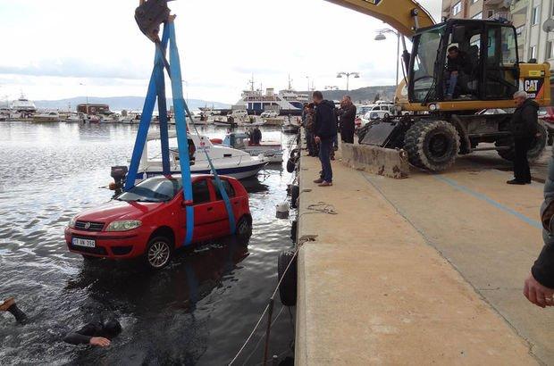 Çanakkale'de otomobil çarptığı tekneyle suya gömüldü