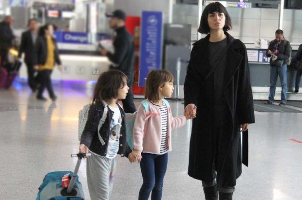 Tuba Büyüküstün çocuklarıyla Paris'e uçtu