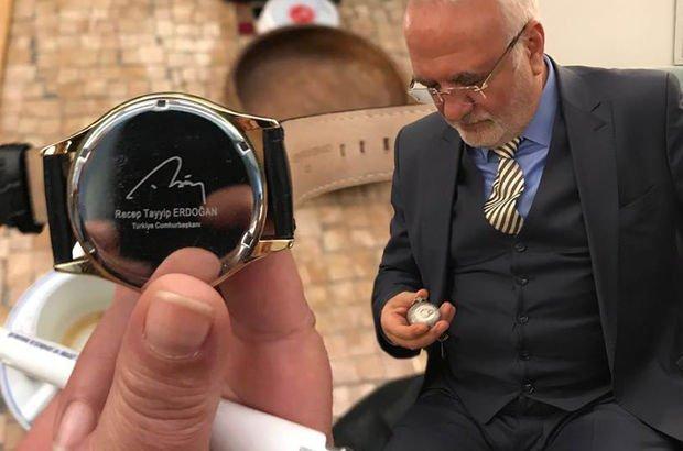 Kolunda Erdoğan, cebinde Bahçeli saati