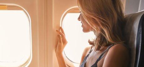 Uçakta cam kenarında oturmak grip riskini azaltıyor