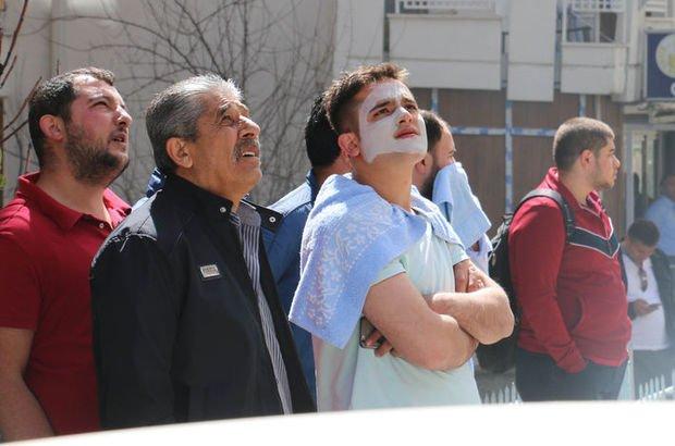 Yüzünde maskeyle dışarı fırladı!
