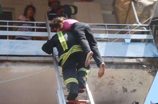 Merdiven boşluğu dumanla kaplanınca mahsur kaldılar