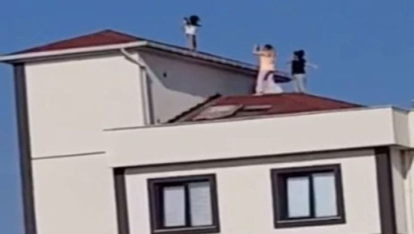 Küçük bir kızı fotoğraf çekmek için çatıya çıkaran sorumsuzlar kamerada