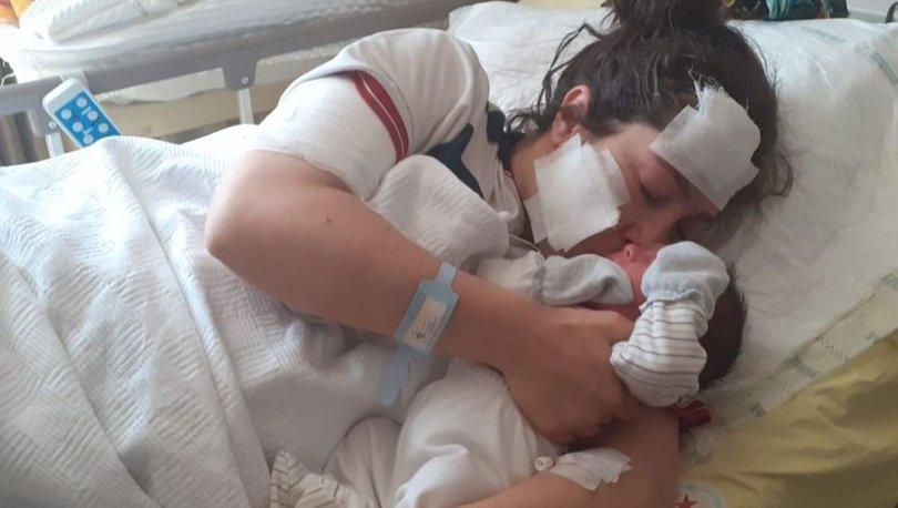 Eşi tarafından bıçaklanan kadın, bebeğini kucağına aldı