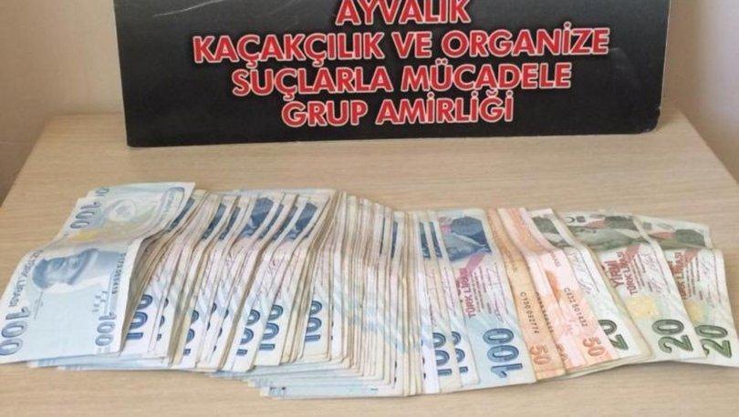 Taksicinin dikkati sahte para şüphelilelerini yakalattı