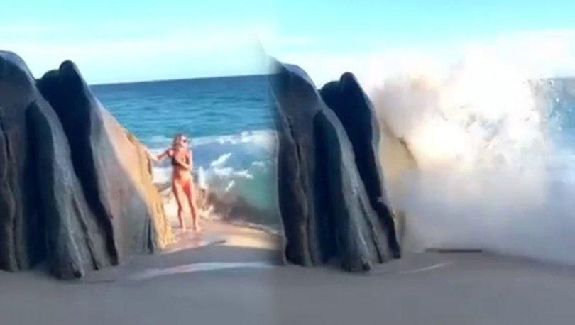 Poz verirken dalgalara kapılan kadın