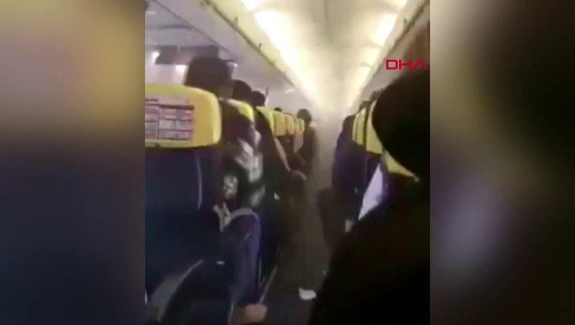 Uçağın içi dumanla doldu… Panik anları kamerada!
