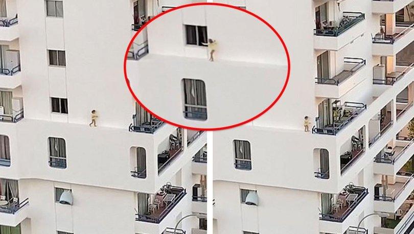 Pencere kenarında yürüyen kız korkuttu