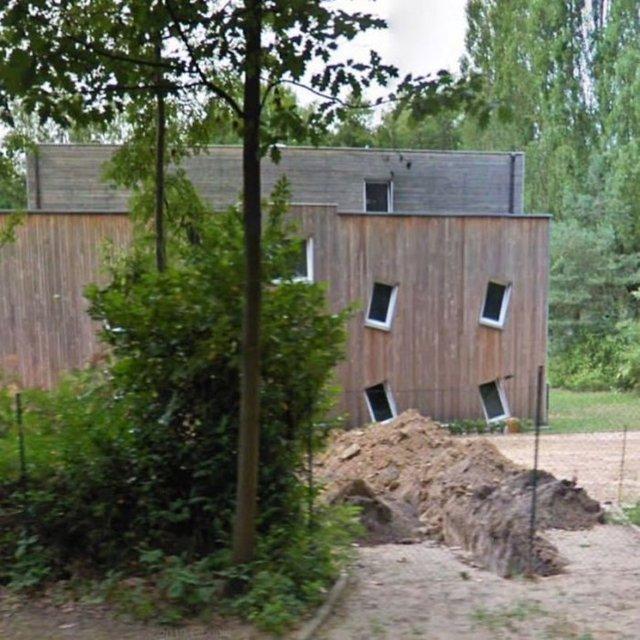 Belçika'nın 'çirkin' evlerini bulup kayıt altına aldı...