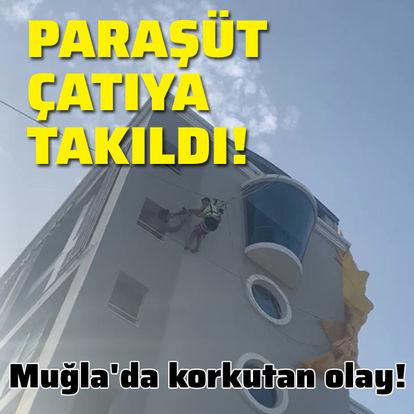 Deniz paraşütüyle otelin çatısına takıldılar!