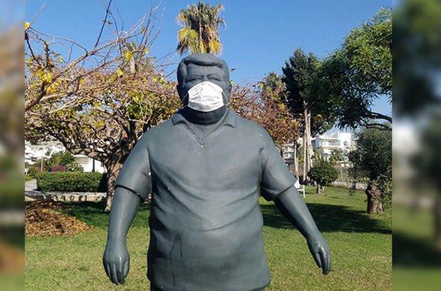Özal'ın heykeline maske takılmasına tepki