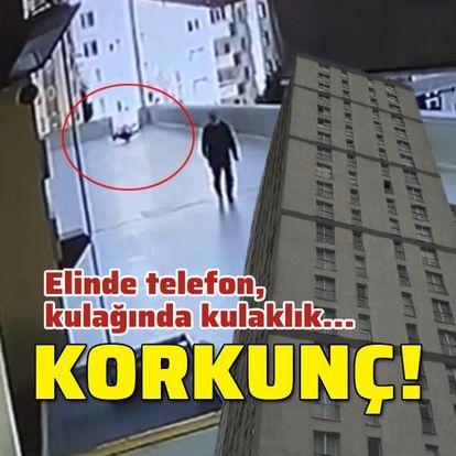 12. kattan düştü! Elinde telefon, kulağında kulaklık...