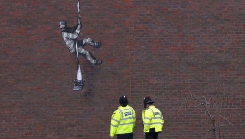 Banksy yeni eserini cezaevi duvarına resmetti