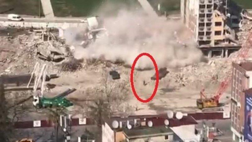 Yıkılan binanın enkazı altında kalmaktan saniyelerle kurtuldu