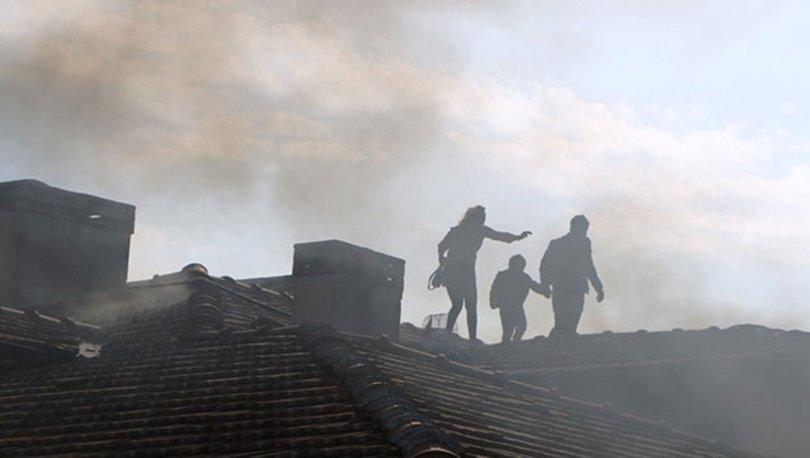 Psikolojik sorunları olan kişi dairesini ateşe verdi, mahsur kalan aile çatıya çıktı