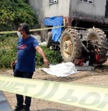 Hareket eden traktörü durdurmak isterken öldü