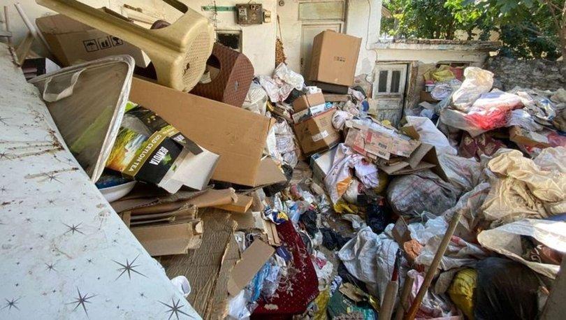 Nazilli'de 'kötü koku' ihbarı ekipleri harekete geçirdi, evden 3 kamyon 'çöp' çıktı