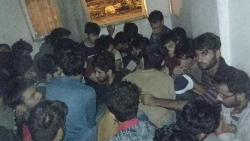 AKILALMAZ OLAY! Son dakika: Van'da, iki apartman dairesinde saklanan 115 kaçak göçmen yakalandı