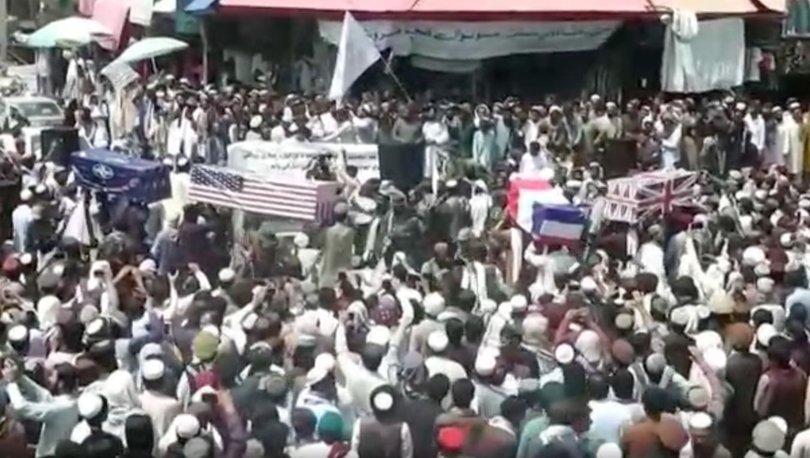 SON DAKİKA: İşgalin sonlanmasıyla Taliban'dan ABD, Fransa, İngiltere bayraklarına sarılı tabutlarla tören