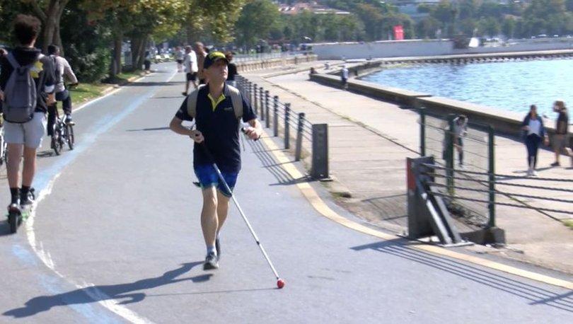 Görme engeline rağmen sınır tanımıyor! Bastonu ve ziliyle günde 14 kilometre koşuyor