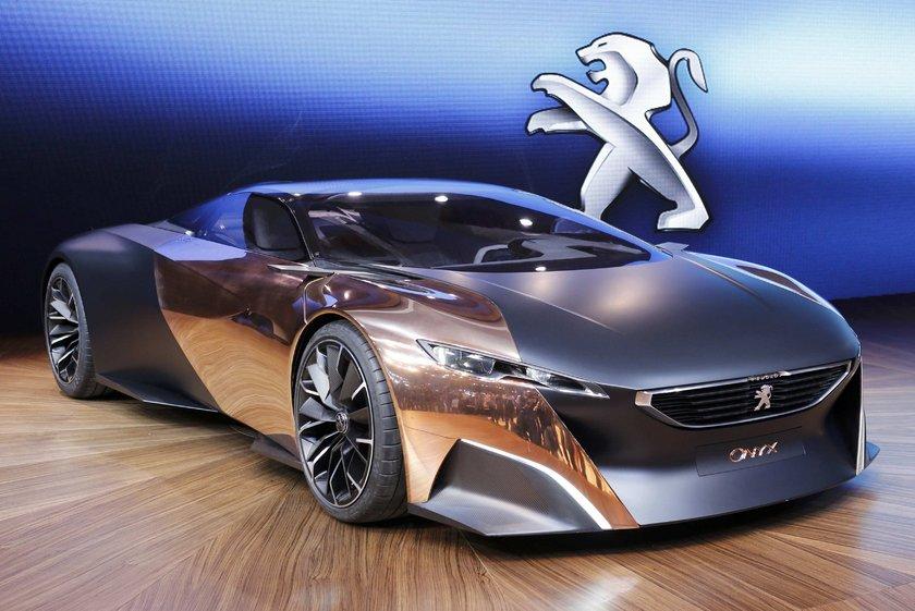Peugeot Onyx uçuşa hazır! :\n\nFransız oto üreticisi Peugeot Onyx konsept tasarımıyla izleyicilerin karşınsa çıktı.\nBakır, karbon alaşımından oluşan dış yüzey Onyx'i otomobilden ziyade havalanmaya hazırlanan bir uzay aracına dönüştürmüş.