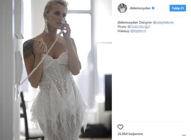 Üzerinde gelinlik, telefonla konuşurken çekilmiş karesini Instagram'da paylaşan Didem Soydan, kısa sürede çok sayıda beğeni aldı.
