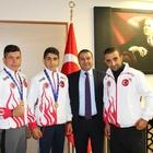 Şampiyon sporcular Kaymakam Yaşar'ı ziyaret etti