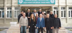 ÇUDEF Başkanı Taş'dan AYBÜ MYO Müdürü Ateş'e teşekkür plaketi