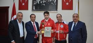 Başkan Toltar, başarılı sporcuyu makamında ağırladı