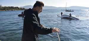 Yarışta su alan yelkenli tekne yan yattı
