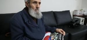 Şehit Kaymakam Safitürk'ün babasına AA 2016 Yıllığı