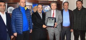 Başkan Taş'tan iş adamı Akgöl'e teşekkür plaketi