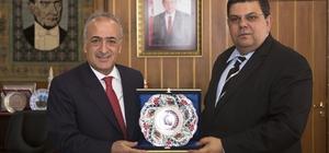 KKTC Milli Eğitim ve Kültür Bakanı, Rektör Çomaklı'yı ziyaret etti