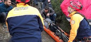 Kayalıklara düşen paraşütçü yaralandı