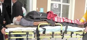 Demir kapının altında kalan kişi yaralandı