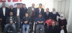 AK Parti'den tekerlekli sandalye dağıtımı