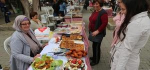 Pazarda gıda ürünleri satan kadınlara hijyen eğitimi